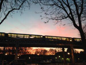 photo of bridge with sunrise lighting in the background