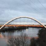lit bridge over river